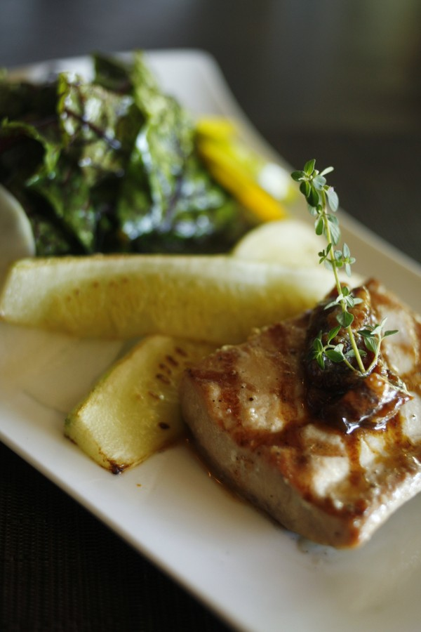Grilling seafood can be intimidating but with a few tricks and a little trial and error great results can be had. A grilled salmon and summer salad dish is served at 18 Seaboard in Raleigh, North Carolina.