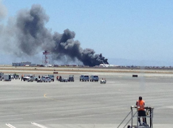 Smoke rises from an Asiana Airlines Boeing 777 after it crashed while landing at San Francisco International Airport in San Francisco on Saturday.