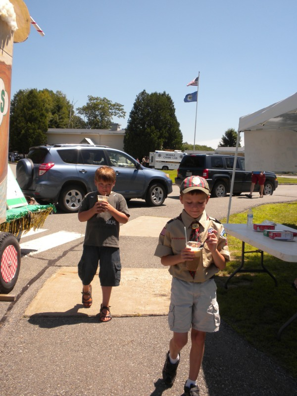 Orrington resident Shane Harriman (front), 9, of Boy Scout Troop 44, and friend Kameron Bouchard, 7, of Old Town, enjoy root beer floats made by Girl Scout Troop 201 at the Orrington Old Home Week post parade expo on Saturday, July 13.