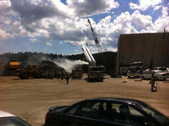 Firefighters from at least five towns were at the scene of a fire in a train car at Grimmel Industries in Topsham on Sunday afternoon.