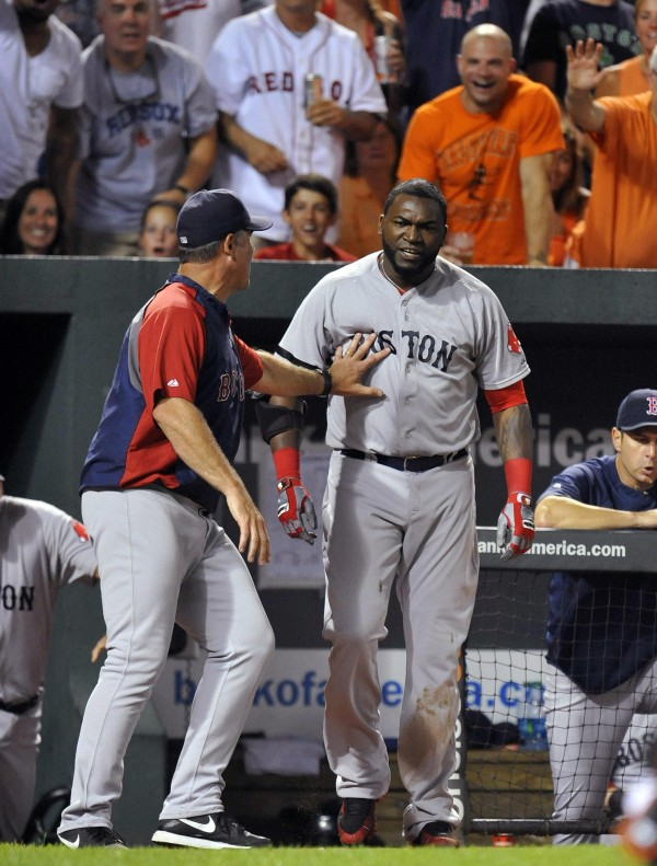 Boston Red Sox designated hitter David Ortiz is restrained by manager John Farrell after being ejected in the seventh inning against the Baltimore Orioles at Oriole Park at Camden Yards Saturday night. The Red Sox defeated the Orioles 7-3.