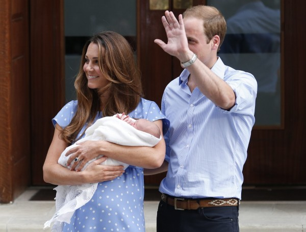 Britain's Prince William and his wife Catherine, Duchess of Cambridge appear with their baby son, as they stand outside the Lindo Wing of St Mary's Hospital, in central London July 23, 2013.  Kate gave birth to the couple's first child, who is third in line to the British throne, on Monday afternoon, ending weeks of feverish anticipation about the arrival of the royal baby.