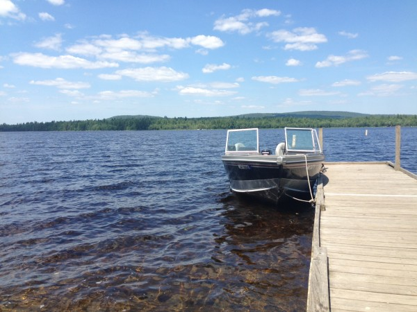 A Maine Warden Service Boat on Great Moose Lake in Hartland Monday. Warden Service divers are searching for a missing boater.