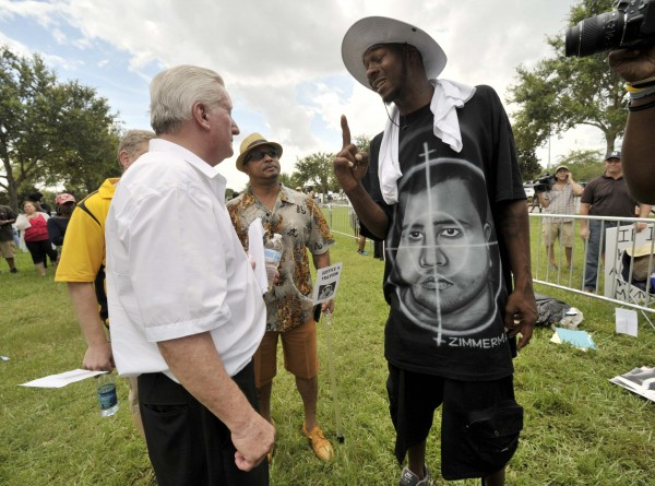 Casey David Kole (left), a supporter of George Zimmerman argues with Ike Thomas of Sanford, Fla., on Saturday outside Seminole County Court in Sanford where George Zimmerman's second-degree murder trial is being deliberated by jurors.