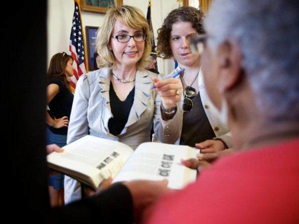 Former Arizona Rep. Gabrielle Giffords signs a book Saturday at Portland City Hall at an event where she called for common sense gun laws.