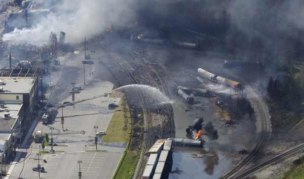 The wreckage of a train is shown after an explosion in Lac-Megantic on July 6, 2013. A fireball leveled the center of the picturesque lakeside town of Lac-Megantic, after the runaway freight train with 72 cars of crude oil derailed, killing about 50 people. The train was owned by Montreal, Maine and Atlantic Railway Corp.
