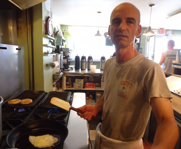 John Martovich, cook at OhNo Cafe in Portland, mans the stoves through a July heat wave.