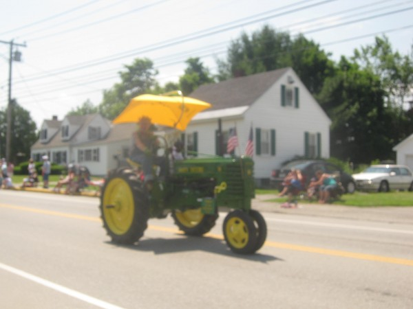 The antique tractor in the Fourth of July parade on Wilson Street in Brewer. An accident involving the vehicle and an antique firetruck later occurred on Water Street where the man on the tractor was killed.