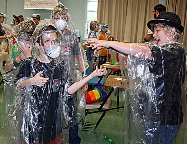 Maine School of Science and Mathematics campers Austin Ahearn of Vassalboro (left) and William St. Pierre of Connor try on the zombie apocalypse survival gear they created during a recent class at the magnet school's summer camp in Limestone. Offered each year, the camp provides students with the opportunity to learn more about science, technology, engineering and mathematics careers they may be interested in.