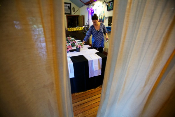 Co-owner Katie Schier Potocki sets the table at the 158 Pickett Street Cafe in South Portland as it is transformed, for one night only, into a foodie paradise by chef Rocco Salvatore Talarico of Supperpie.