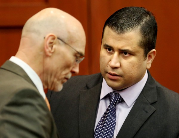 George Zimmerman (right) talks to defense counsel Don West after the jury leaves the courtroom for more deliberations on the 25th day of his trial at the Seminole County Criminal Justice Center in Sanford, Fla., on Saturday, July 13, 2013.