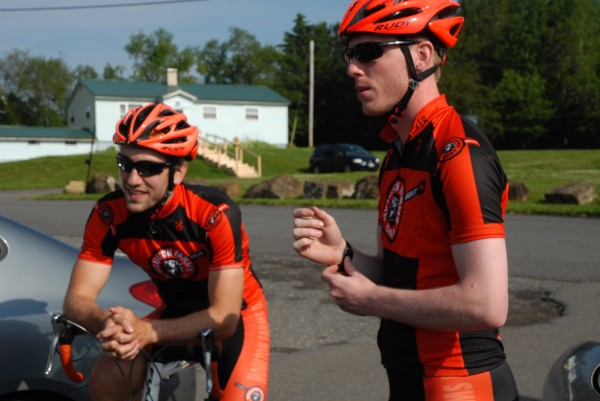 Team Houlton Farms Dairy members Brian Hupe [left] and Brad Baker prepare to lead a group of cyclists on a ride from Caribou to Houlton on Friday in the Tour de Houlton Farms Dairy.