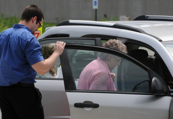 Jordan Trask helps his grandmother Ruth Trask into a waiting car at the Penobscot Judicial Center in Bangor on Wednesday.