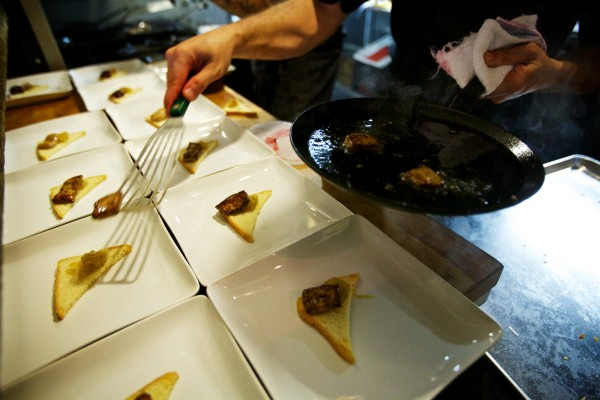 Sous chef Mike Francis serves seared foie gras at a pop-up dinner by Supperpie in South Portland.