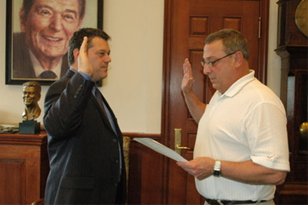 Gov. Paul LePage (right) administered the oath Friday, June 3, 2011, to George Gervais as Commissioner of the Department of Economic and Community Development.