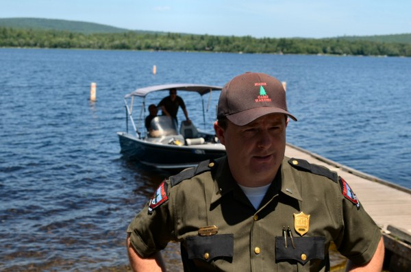 Maine Warden Service Lt. Kevin Adam addresses the media on Monday, July 15, while divers search for a man missing in Great Moose Lake in Hartland since Sunday.