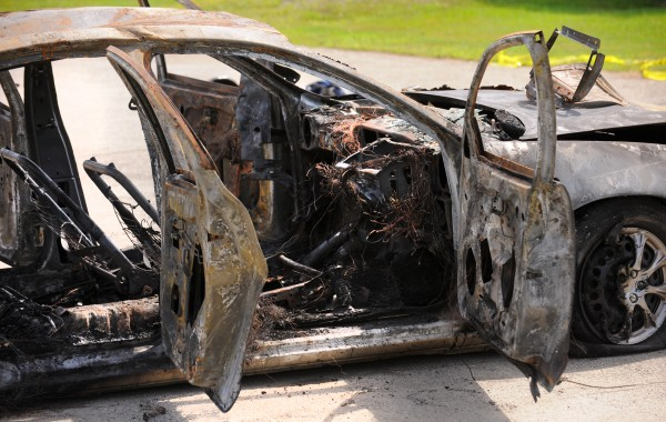 The burned out car that had three bodies in it on Target Industrial Circle in Bangor.