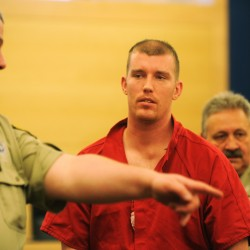Suspect in triple homicides pleads not guilty to 3 murders, arson; judge denies bail