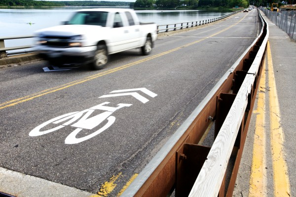 Cars and trucks pass over the Martin's Point Bridge on Thursday morning between Falmouth and Portland, over markings indicating the shared use with bicycles