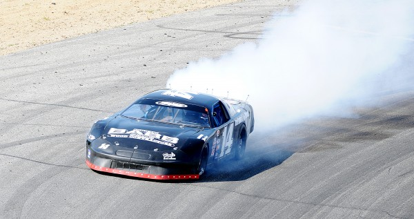 Brad Babb from Windham loses his engine during a consolation race after leading the field for the majority of the race Sunday at Oxford Plains Speedway.
