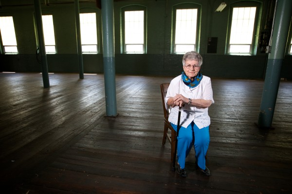 Claire Junkins, 86, returned to the Pepperell Mill in Biddeford Tuesday to be interviewed for a Biddeford Mills Museum oral history project. Junkins, a Viger before she was married, worked in the mill for 16 years folding 5,000 blankets a day.