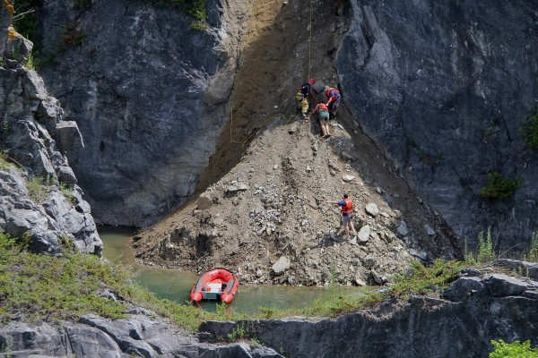 Rockland and Thomaston fire departments worked to rescue a young woman who slipped down the side of w a water-filled quarry Tuesday afternoon.