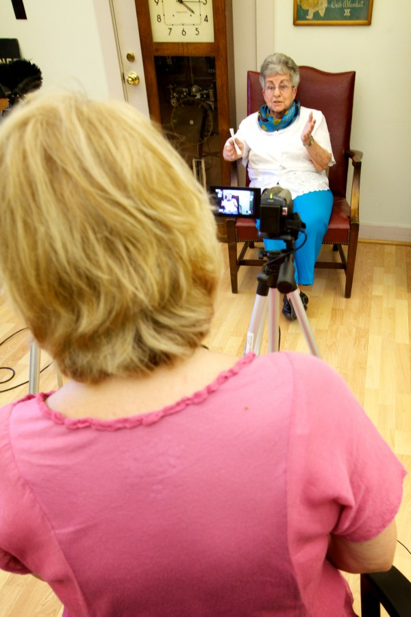 Biddeford Mills Museum volunteer Maureen Lyons videotapes an interview with Claire Junkins Tuesday in Biddeford. Junkins worked at the Pepperell Mill for 16 years starting in 1943.