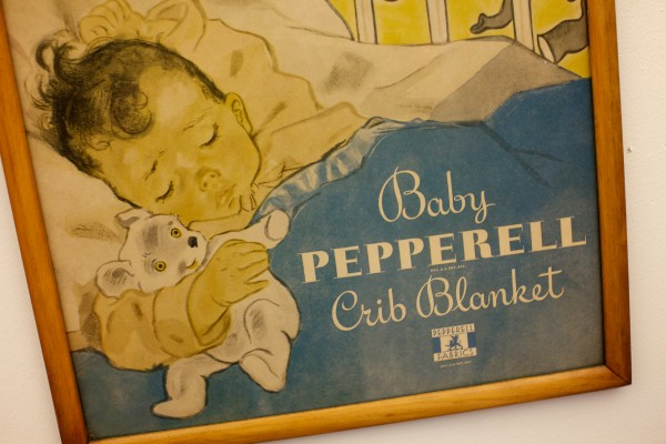An old poster hangs on the wall at the Biddeford Mills Museum in Biddeford Tuesday.