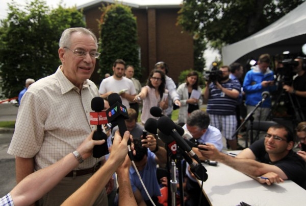 Ed Burkhardt, chairman of Montreal, Maine and Atlantic Railway, speaks to the media as he arrives in Lac-Megantic, Quebec, Wednesday.