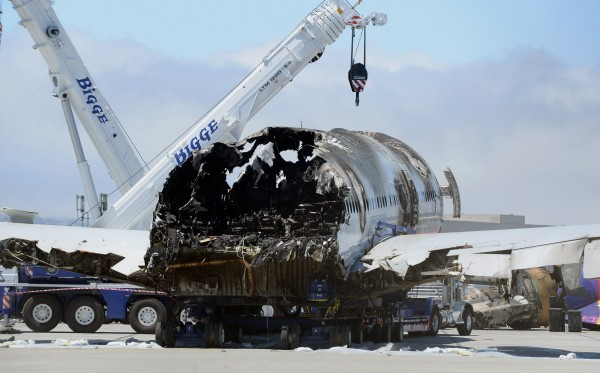 The remains of the Asiana Airlines Boeing 777 have been collected in a remote parking area at the San Francisco International Airport in San Francisco, California, on Friday, July 12, 2013.