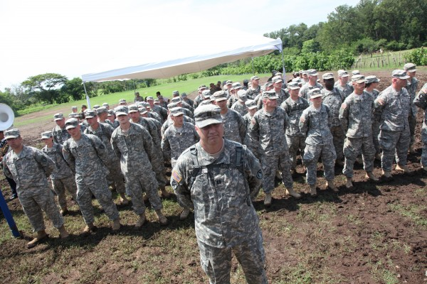 Capt. Steven Morin, commander of the 136th Engineer Company, based in Lewiston, stands in front of the second group of about 70 soldiers in his unit who went to El Salvador this summer to build schools and latrines as part of an international humanitarian and training exercise called Beyond the Horizon-El Salvador 2013.