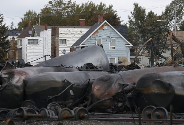 Melted siding on a house is pictured close to the train wreckage in Lac-Megantic. Several people were missing after four tank cars of petroleum products exploded in the middle of a small town in the Canadian province of Quebec early on Saturday in a fiery blast that destroyed dozens of buildings.