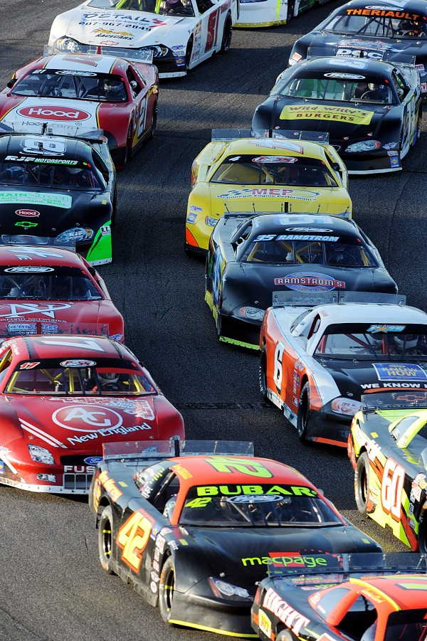 A group of car get stacked up after a caution during the TD 250 Sunday.