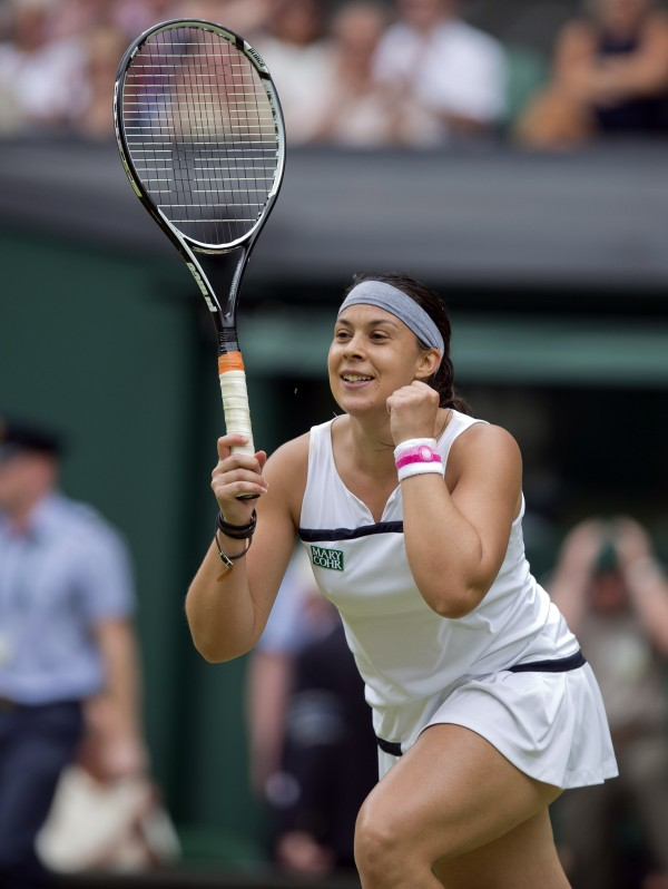 Marion Bartoli celebrates recording match point during her match against Kirsten Flipkens on day 10 of the 2013 Wimbledon Championships at the All England Lawn Tennis Club.