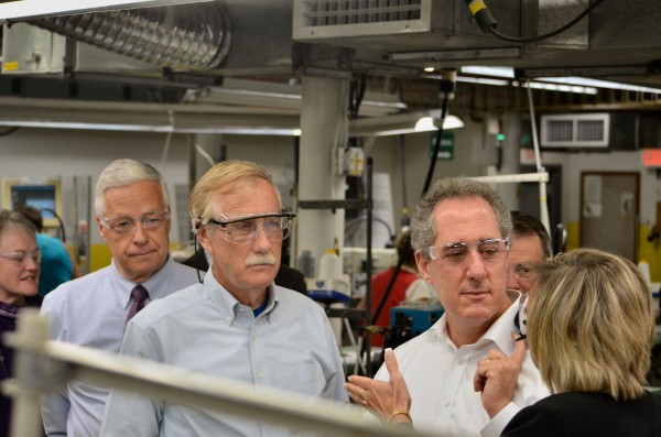 U.S. Trade Representative Michael Froman (right) listens about work in the New Balance factory in Norridgewock on Monday. U.S. Rep. Mike Michaud, D-Maine (left), and U.S. Sen. Angus King, I-Maine, also listen.