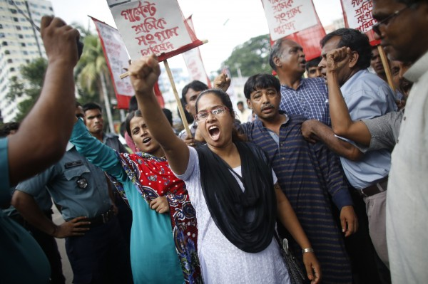 Garment workers and activists shout slogans as they take part in a protest against the suspension of trade benefits by the U.S. in Dhaka June 30, 2013.
