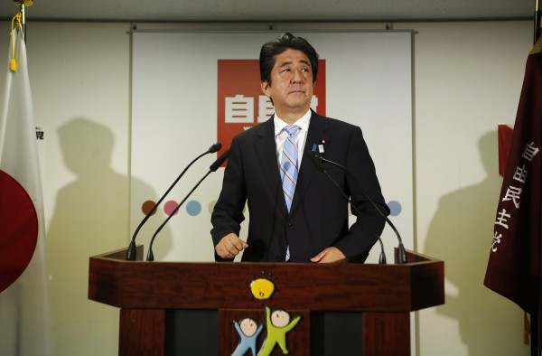 Japan's Prime Minister and the leader of the ruling Liberal Democratic Party, Shinzo Abe, makes an appearance before the media at a news conference following a victory in the upper house elections by his ruling coalition, at the LDP headquarters in Tokyo July 22, 2013. Abe said on Monday that his government would lose public confidence if it retreated from reform.