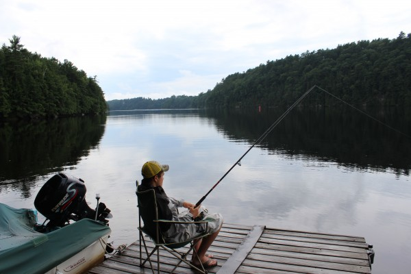 Hunter Pate, 16, of Orrington, fishes for striped bass from his family's dock on the Penobscot River recently.