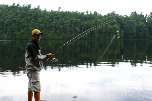 Hunter Pate, 16, of Orrington tries to catch some striped bass from his family's dock on the Penobscot River.