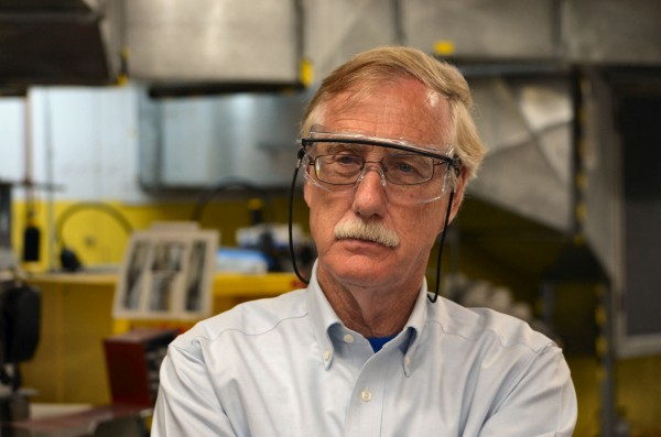 U.S. Sen. Angus King, I-Maine, looks on as employees work at the New Balance factory in Norridgewock on Monday.