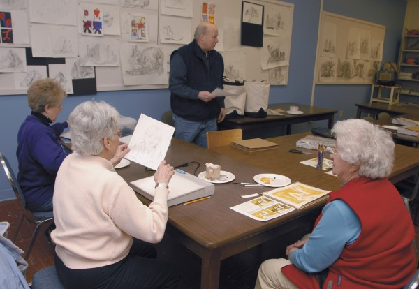 Lincoln artist David Whalen teaches a Penobscot Valley Senior College class in watercolor painting at Eastport Hall on the University of Maine at Augusta-Bangor campus on Friday, March 8, 2013.