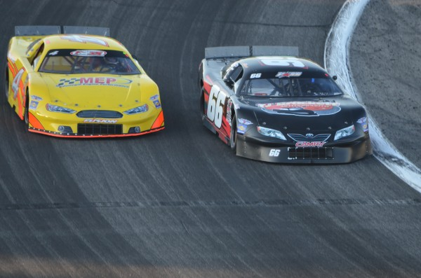 T.J. Brackett of Buckfield (66) races inside Ben Rowe of Turner (4) in the early stages of the TD Bank 250 on Sunday. Morrill's Travis Benjamin took the win.
