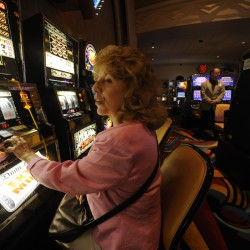 Elizabeth Milliken of Old Orchard Beach looks toward her husband who was playing a nearby slot machine at Hollywood Casino — then Hollywood Slots — in Bangor in June 2009.