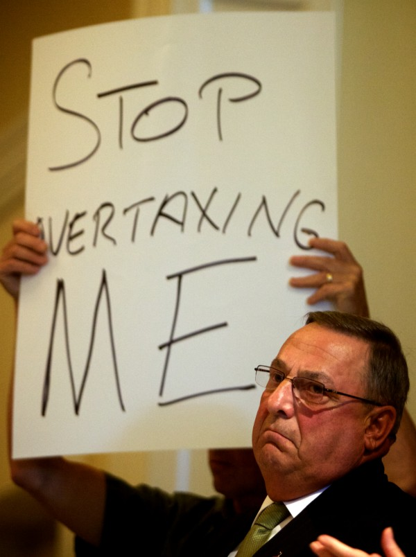 Governor Paul LePage renewed his pledge to veto the state budget at an Americans for Prosperity rally at the State House in Augusta on June 20.