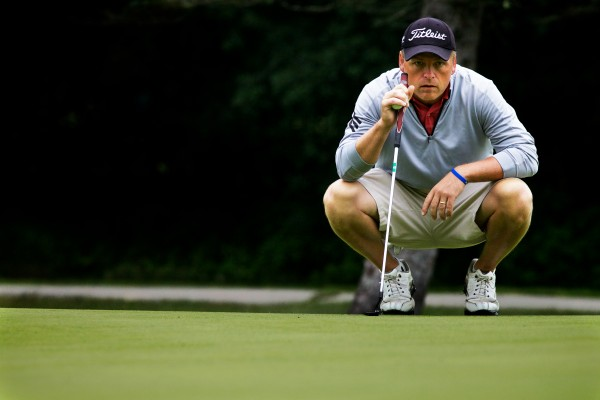Ricky Jones of the Samoset Resort Golf Club lines up a putt at the 94th Maine Amateur Championship being held at Augusta Country Club in Manchester on Wednesday morning.