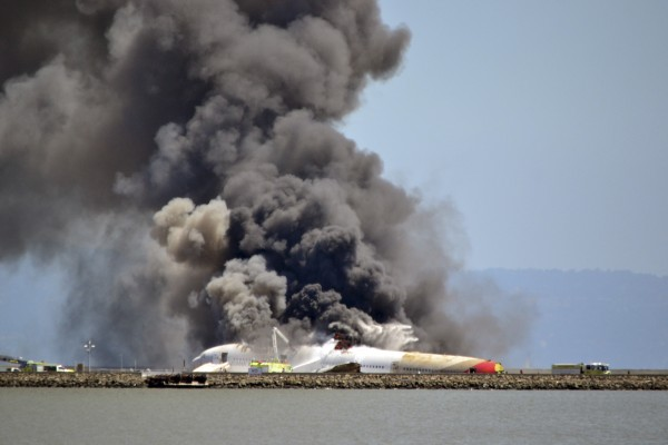 Asiana Airlines flight 214 burns on the runway at San Francisco International Airport after crash landing Saturday.