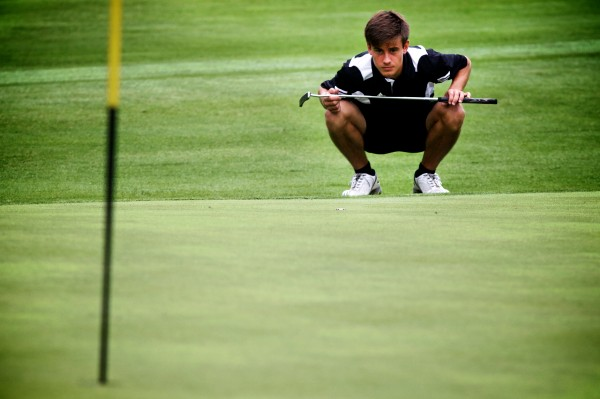 Jordan Jones lines up a putt at the 94th Maine Amateur Championship being held at Augusta Country Club in Manchester on Wednesday morning.