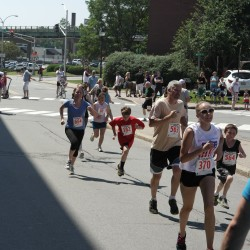 Several runners approach the finish line after a hot run from Brewer to Bangor during Thursday's Walter Hunt Memorial 3K road race on the 4th of July.