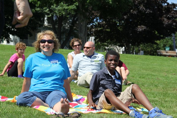 Jayden Defreitas, 11 of the Bronx, N.Y., and his host Lisa Dearborn of Biddeford relax at the start of a recent Fresh Air Fund event in Portland.