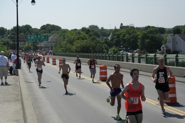 Several of the approximately 600 runners entered in Thursday's Walter Hunt Memorial 3K cross the Joshua Chamberlain Bridge into Bangor on the 4th of July.